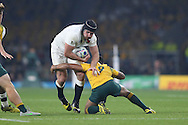 Ben Morgan of England is tackled by Will Genia of Australia. Rugby World Cup 2015 pool A match, England v Australia at Twickenham Stadium in London, England  on Saturday 3rd October 2015.<br /> pic by  John Patrick Fletcher, Andrew Orchard sports photography.