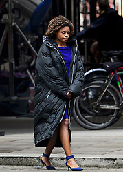 """© Licensed to London News Pictures. 30/05/2015. London, UK. Filming for the new James Bond film """"Spector"""" with Daniel Craig (not pictured) and Naomie Harris (pictured) at the courtyard of the UK Government Treasury building in Westminster, London . Photo credit: Ben Cawthra/LNP"""