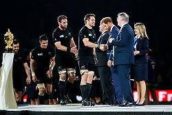 New Zealand Flanker Richie McCaw (capt) is congratulated by World Rugby President Bernard Lapasset after New Zealand win the match 34-17 to become 2015 World Cup Champions - Mandatory byline: Rogan Thomson/JMP - 07966 386802 - 31/10/2015 - RUGBY UNION - Twickenham Stadium - London, England - New Zealand v Australia - Rugby World Cup 2015 FINAL.