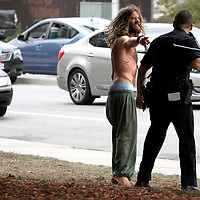 Oliver Howard, 32, gestures angrily at Santa Cruz police officer Ryan Kiar, after Kiar unsuccessfully attempted to stun Howard with his Taser during an altercation next to the Santa Cruz County Courthouse on Water Street in Santa Cruz, California as a bystander looks on.  Officer Kiar believed Howard was under the influence of narcotics and prevented him from returning to the wheel of his car after Howard initiated an interaction with Kiar while he was making an unrelated traffic stop with another motorist. The two argued while Kiar waited for backup and the situation escalated when Howard physically challenged the officer. Once backup arrived Howard was stunned and handcuffed. Howard was arrested on suspicion of resisting arrest, battery on a police officer and driving under the influence of drugs.<br /> Photo by Shmuel Thaler <br /> shmuel_thaler@yahoo.com www.shmuelthaler.com
