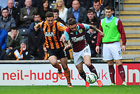 Burnley's Danny Ings vies for possession with Hull City's James Chester<br /> <br /> Photographer: Chris Vaughan/CameraSport<br /> <br /> Football - Barclays Premiership - Hull City v Burnley - Saturday 9th May 2015 - Kingston Communications Stadium - Hull<br /> <br /> © CameraSport - 43 Linden Ave. Countesthorpe. Leicester. England. LE8 5PG - Tel: +44 (0) 116 277 4147 - admin@camerasport.com - www.camerasport.com