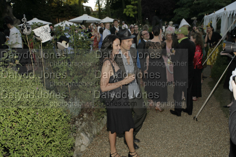 Paul Simonon and Trish Simonon, Stephen Jones Summer Hat party to celebrate 25 years of Milllinery. Debenham House, 8 Addison Rd. Holland Park, London. 13 July 2006.  ONE TIME USE ONLY - DO NOT ARCHIVE  © Copyright Photograph by Dafydd Jones 66 Stockwell Park Rd. London SW9 0DA Tel 020 7733 0108 www.dafjones.com