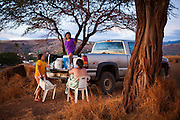 The Higashi sisters (l-r) Rachele, Josie, and Leilani, from Kekaha, enjoy the sunset from their mother's pickup truck parked over the beach at Waimea, Kauai, Hawaii.