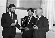 28/04/1964<br /> 04/28/1964<br /> 28 April 1964<br /> Nations Trophy for Westport Sea Angling Festival. The trophy for the 1st staging at Clew Bay of an International Team - of - two competition this year was handed to the Irish Federation of Sea Anglers at Verbiage Enterprises Ltd., Pearse Street, Dublin, designers of the trophy that would be competed for by a number of European teams and a team from the U.S. armed forces in Germany. Picture shows Bernard Share, M.A., Verbiage Enterprises Ltd. (left) presenting the trophy and replicas to Captain C.P. O'Toole, Honorary Secretary Irish Federation of Sea Anglers. Centre is William Bolger, A.I.C.A.D. of Verbiage Enterprises Ltd..