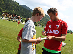 14.07.2013, Walchsee, AUT, FC Augsburg, Trainingslager, im Bild Daniel BAIER (FC Augsburg #10) schreibt Autogramme // during a trainings session of German 1st Bundesliga club FC Augsburg at their training camp in Walchsee, Austria on 2013/07/14. EXPA Pictures © 2013, PhotoCredit: EXPA/ Eibner/ Klaus Rainer Krieger<br /> <br /> ***** ATTENTION - OUT OF GER *****