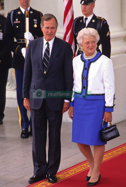 United States President George H.W. Bush, left, and first lady Barbara Bush, right, watch as President Mikhail Gorbachev of the Union of Soviet Socialist Republics and his wife, Raisa, depart on the North Portico of the White House in Washington, DC on Sunday, June 3, 1990. The Gorbachevs were in Washington for a three day summit that included visits to Wellesley, Massachusetts and Camp David, the presidential retreat near Thurmont, Maryland. Photo by Howard L. Sachs / CNP /ABACAPRESS.COM