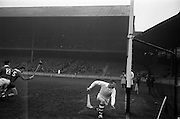 17/03/1965<br /> 03/17/1965<br /> 17 March 1965<br /> Railway Cup Hurling final  Munster v Leinster at Croke Park, Dublin. Ollie Walsh, Leinster keeper, sees the ball go wide of his goals with Leinster's T Neville (2) and Munster's L. Devaney (15) closing in.