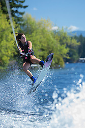 United States, Washington, Lake Sawyer, teen girl doing a wakeboarding jump.  MR