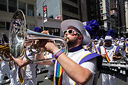 New York, NY - 30 June 2019. The New York City Heritage of Pride March filled Fifth Avenue for hours with participants from the LGBTQ community and it's supporters. A musician from the Lesbian & Gay Big Apple Corps plays a tuba.
