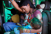 Rashni, 21, is holding her son Badel, 2, a boy suffering from a severe neurological disorder while sitting on a bus owned by Chingari Trust, the local NGO caring for disabled  children in Bhopal, Madhya Pradesh, India, near the abandoned Union Carbide (now DOW Chemical) industrial complex.