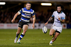 Bath Inside Centre Sam Burgess, making his first start for the Club, kicks on as Montpellier replacement Rene Ranger challenges - Photo mandatory by-line: Rogan Thomson/JMP - 07966 386802 - 12/12/2014 - SPORT - RUGBY UNION - Bath, England - The Recreation Ground - Bath Rugby v Montpellier Herault Rugby - European Rugby Champions Cup Pool 4.