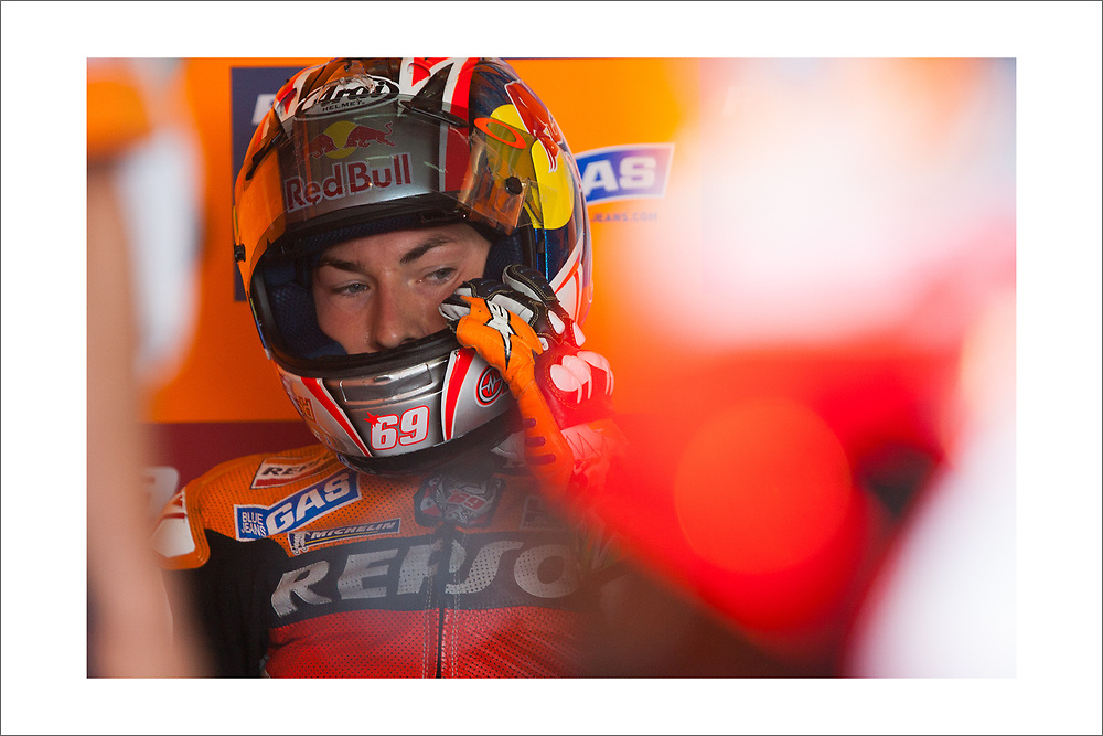 This print is of Nicky Hayden (1981-2017) waiting for track time at Sachsenring MotoGP during his world championship-winning season.