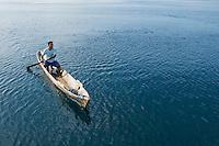 Local resident paddles a canoe near Beloi, Atauro Island, Timor-Leste (East Timor)