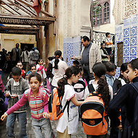Fes el Bali, Morocco, 25 October 2006<br /> Children leaving the school.<br /> A Madrasa (also Medersa, a koranic school) of Fes.<br /> The Medina of Fes is believed to be the largest contiguous car-free urban area in the world. <br /> Fes el Bali is classified as a UNESCO World Heritage Site.<br /> Photo: Ezequiel Scagnetti
