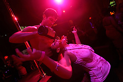 A patron drinks during a striptease show in New York.