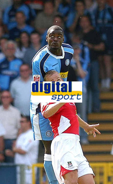 Photo: Alan Crowhurst.<br />Wycombe Wanderers v Wrexham. Coca Cola League 2.<br />05/08/2006. Wycombe's Will Antwi oujumps Neil Roberts for the ball