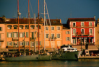 Sailboats lie in harbour in late afternoon sun, St. Tropez, France