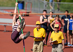 Lebanon senior Will Tanski attempts to clear the bar during the NHIAA Division II track and field championship at UNH on Saturday, May 25, 2019.  (Alan MacRae/Valley News)