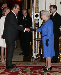 File photo dated 17/02/14 of Queen Elizabeth II meeting Sir Roger Moore during a Reception for the Dramatic Arts at Buckingham Palace, London. Sir Roger has died in Switzerland after a short battle with cancer, his family has announced.