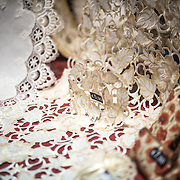 Belgian lace on display in a shop window in the historic center of Bruges, Belgium. The Flanders region is famous for the quality of its fine lace.