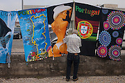 Sexist and Portugal souvenir towel merchandise in the market town of Estarreja, Portugal.