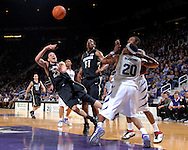 Colorado guard Richard Roby (23) throws up a shot over Kansas State defenders Cartier Martin (20) and Akeem Wright, as teammate Jermyl Jackson-Wilson (31) looks on in the first half at Bramlage Coliseum in Manhattan, Kansas, February 10, 2007.  K-State beat Colorado 78-59.