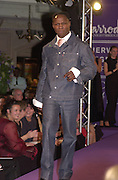 Chris Eubank. The City Fashion Show and dinner in aid of the NSPCC. Harrod's. 10 October 2000. © Copyright Photograph by Dafydd Jones 66 Stockwell Park Rd. London SW9 0DA Tel 020 7733 0108 www.dafjones.com