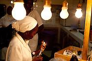 A nurse prepares to deliver medecine to a patient in Senegal.