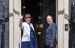 File photo dated 13/06/17 of DUP leader Arlene Foster and DUP deputy leader Nigel Dodds arriving at 10 Downing Street in London. Theresa May is still trying to cut a deal with the Democratic Unionists days before her minority Government attempts to get its Queen's Speech legislative package approved by the Commons.