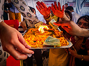 "23 SEPTEMBER 2018 - BANGKOK, THAILAND: People pray and makes offerings at the Ganesha Festival at Wat Dan in Bangkok. Ganesha Chaturthi also known as Vinayaka Chaturthi, is the Hindu festival celebrated on the day of the re-birth of Lord Ganesha, the son of Shiva and Parvati. The festival, also known as Ganeshotsav (""festival of Ganesha"") is observed in the Hindu calendar month of Bhaadrapada, starting on the the fourth day of the waxing moon. The festival lasts for 10 days, ending on the fourteenth day of the waxing moon. Outside India, it is celebrated widely in Nepal and by Hindus in the United States, Canada, Mauritius, Singapore, Thailand, Cambodia, and Burma.   PHOTO BY JACK KURTZ"