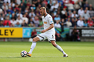 Mike van der Hoorn of Swansea city in action.  Premier league match, Swansea city v Watford at the Liberty Stadium in Swansea, South Wales on Saturday 23rd September 2017.<br /> pic by  Andrew Orchard, Andrew Orchard sports photography.