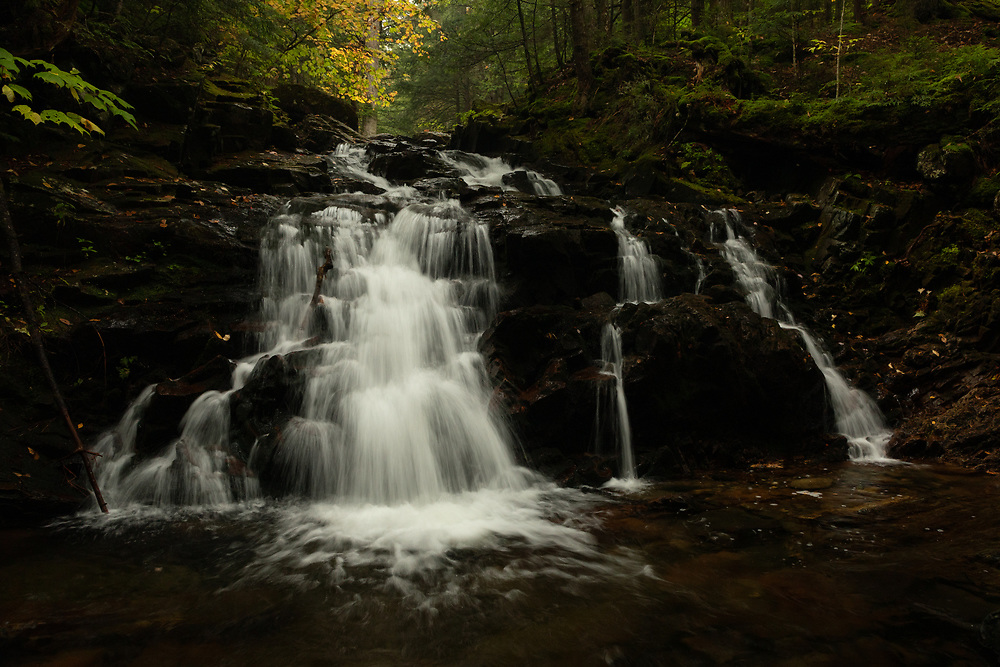 The rugged descent of water at Gordon Falls in the White Mountains.
