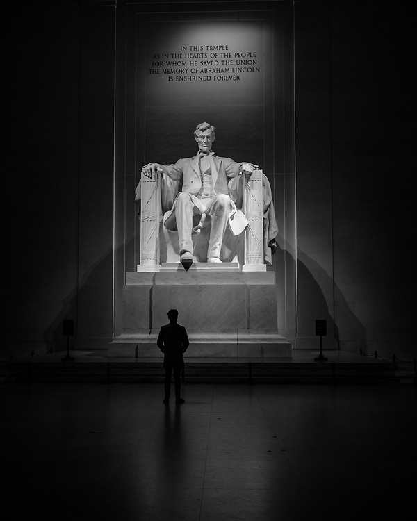 A man standing in front of the Lincoln Memorial on a cold autumn evening in Washington DC.