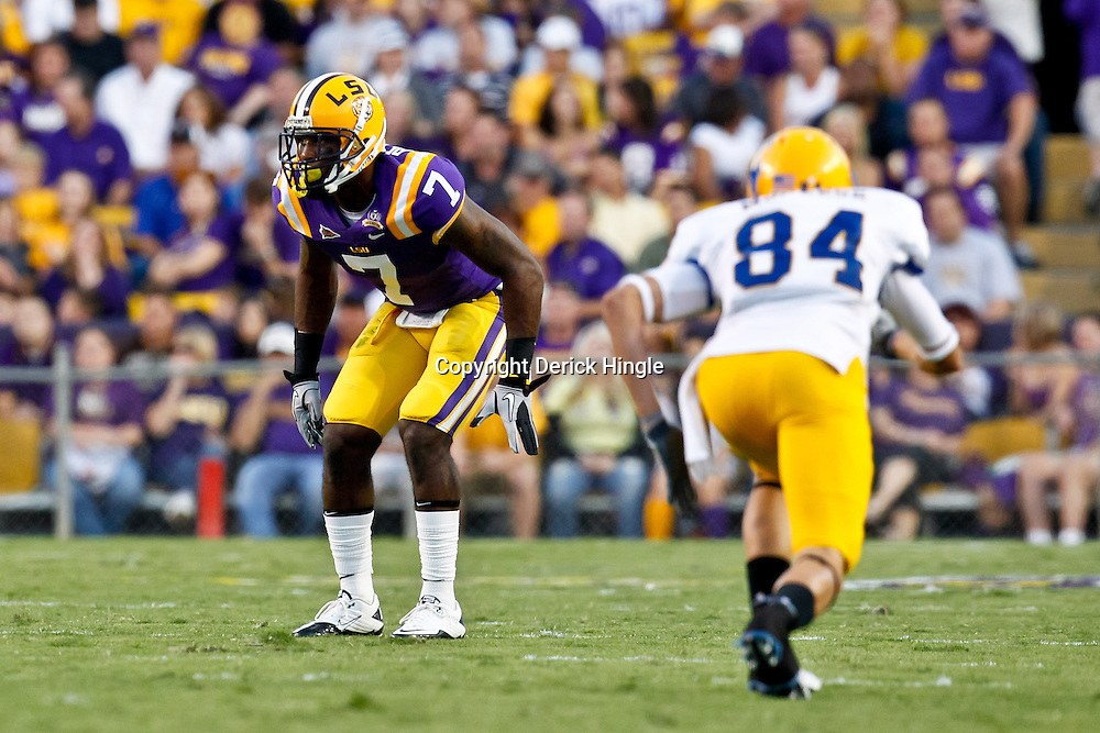 October 16, 2010; Baton Rouge, LA, USA; LSU Tigers cornerback Patrick Peterson (7) defends against McNeese State Cowboys wide receiver Wes Briscoe (84) during a game at Tiger Stadium. LSU defeated McNeese State 32-10. Mandatory Credit: Derick E. Hingle