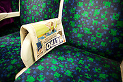 Scene depicting the Metro newspaper on a London Underground District Line Train. This free daily paper has become a main news source for Londoners.