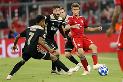 (l-r) David Neres of Ajax, Lasse Schone of Ajax, Thomas Muller of FC Bayern Munchen during the UEFA Champions League group E match between Bayern Munich and Ajax Amsterdam at the Allianz Arena on October 02, 2018 in Munich, Germany