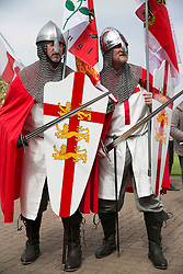 © Licensed to London News Pictures. 23/04/2015. Nottingham, UK. The Nottingham St George's parade took part today. The parade met in Forest Recreation Ground. An estimated two hundred people with trucks playing patriotic music and horses dressed in flags made their way along the streets into the City Centre. Pictured, two knights of Nottingham. Photo credit : Dave Warren/LNP
