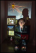 ALEX MAY IN FRONT OF HIS VIDEO SCULPTURE , Kinetica Art Fair, Truman Building, Brick Lane, London. London. 16 October 2014