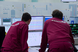 Employees monitors the production of electricity in the control room at the Essent Energie power station, in Geertruidenberg, Netherlands, on Monday March 22, 2010. Essent Energie is owned by RWE AG. (Photo © Jock Fistick).