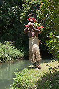 South Pacific, The Republic of Vanuatu, Shefa Provence, Epule River Valley Islander in traditional dress blows a shell