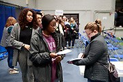 02032020 - Des Moines, Iowa, USA: Iowa Caucus goers participate in the 2020 Iowa Caucuses at Knapp Center at Drake University, Monday, February 3, 2020 in Des Moines, Iowa. (Jeremy Hogan/Polaris)