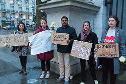 Three women, Joan Crowley, Maeve O'Reilly and Aoife Hamill are joined by passersby as they brave the chilly, damp evening at Marble Arch in London to hold their own #IBelieveHer protest after a rape trial jury in Belfast cleared two Irish rugby stars who boasted online that sex with the same woman was 'like a merry go round'. London, March 29 2018.