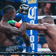 Luis Ortiz (r) lands a straight left hand to the chin of Deontay Wilder during the WBC Heavyweight Championship boxing match at Barclays Center on Saturday, March 3, 2018 in Brooklyn, New York. Wilder would win the bout by knockout in the tenth round to retain the title and move to 40-0. (Alex Menendez via AP)