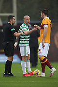 Fist pumps from the captains during the Scottish Premiership match between Motherwell and Celtic at Fir Park, Motherwell, Scotland on 8 November 2020.