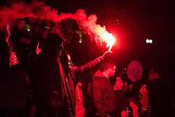 London, November 5th 2016. Anti-capitalists and anarchists participate in the Million Mask March, an annual event that happens on November 5th each year in cities across the world, as part of a protest against the establishment. Many of the protesters wear Guy Fawkes masks, often associated with the internet activism group Anonymous. PICTURED: Protesters burn a flare in Trafalgar square.