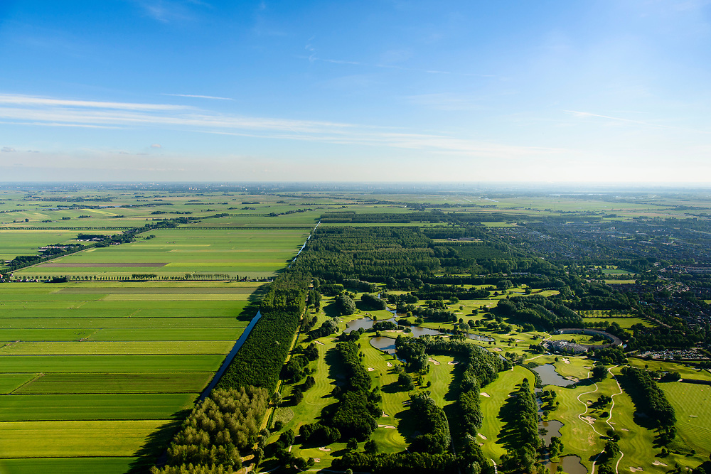 Nederland, Noord-Holland, Purmerend, 13-06-2017; Polder De Purmer gezien naar  Amsterdam-Noord. Purmerbos met golfbaan on de voorgrond. Polder Purmer.<br /> luchtfoto (toeslag op standaard tarieven);<br /> aerial photo (additional fee required);<br /> copyright foto/photo Siebe Swart