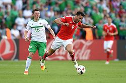 Corry Evans of Northern Ireland fouls Hal Robson-Kanu of Wales  - Mandatory by-line: Joe Meredith/JMP - 25/06/2016 - FOOTBALL - Parc des Princes - Paris, France - Wales v Northern Ireland - UEFA European Championship Round of 16
