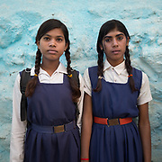 School students ready to leave for school, wearing uniform. Jabalpur.