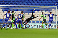 Cardiff City's Craig Noone (11) beats AFC Wimbledon goalkeeper James Shea  to score his teams 1st goal from a freekick.  Capital One cup match, 1st round, Cardiff city v AFC Wimbledon at the Cardiff city stadium in Cardiff, South Wales on Tuesday 11th August  2015.<br /> pic by Carl Robertson, Andrew Orchard sports photography.
