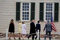 Doug Bradburn, president and chief executive officer of George Washington's Mount Vernon, from right, Emmanuel Macron, France's president, U.S. President Donald Trump, Sarah Miller Coulson, regent with the Mount Vernon Ladies' Association, Brigitte Macron, France's first lady, and U.S. First Lady Melania Trump tour outside the Mansion at the Mount Vernon estate of first U.S. President George Washington in Mount Vernon, Virginia, U.S., on Monday, April 23, 2018. As Macron arrives for the first state visit of Trump's presidency, the U.S. leader is threatening to upend the global trading system with tariffs on China, maybe Europe too. Photographer: Andrew Harrer/Bloomberg